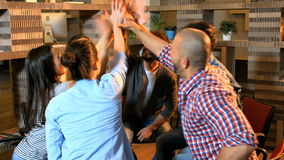 Group of business executive giving high five to each other stock footage