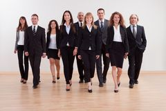 Group of business executives approaching Royalty Free Stock Image