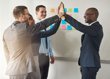 Group of business executives congratulating Royalty Free Stock Image
