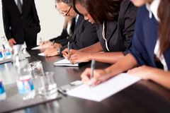 Group of business executives taking notes Royalty Free Stock Photo