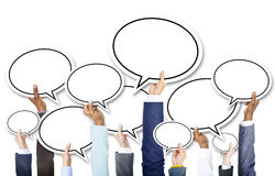 Group of Business Hands Holding Speech Bubbles Stock Photography
