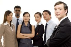 Group Business Leader 2. A young man stands in front of his business team (shallow depth-of-field used Stock Photos