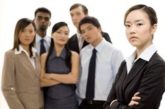 Group Business Leader 3. A young woman (in focus) stands in front of her business team Royalty Free Stock Photos