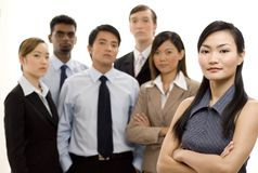 Group Business Leader 4. An attractive young asian team leader (in focus) stands in front of her team Royalty Free Stock Photos