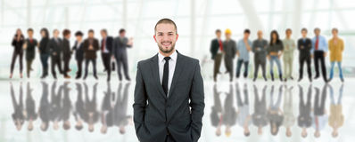 Group. Business man in front of a group of people Stock Photo