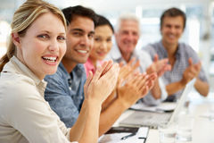 Group in business meeting. Mixed group in business meeting clapping smiling to camera Royalty Free Stock Photography