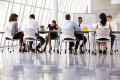 Group Business Meeting Around Table In Modern Office Royalty Free Stock Photo