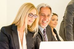 Group in business meeting with laptop royalty free stock photography
