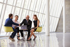 Group Business Meeting In Reception Of Modern Office Royalty Free Stock Photos