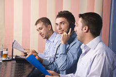 Group of business men in office Royalty Free Stock Images