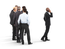 Group of business men with one emerging to the front Royalty Free Stock Image