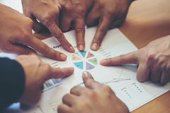 Group of business partners discussing ideas analysis and planning work in office. stock images