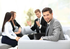 Group of business partners discussing ideas with their leader on Stock Photo