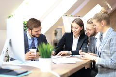 Group of business partners discussing strategies at meeting in office.  royalty free stock photography