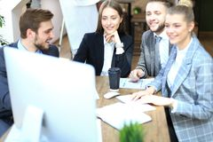 Group of business partners discussing strategies at meeting in office.  royalty free stock images
