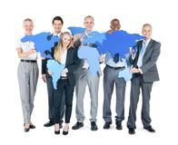 Group of Business People with continents stock photography