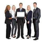 Group of business people advertising a new laptop Stock Photo
