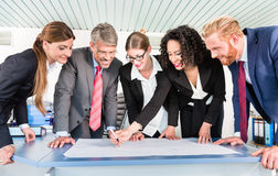 Group of business people analyzing data Stock Images