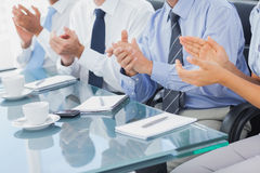 Group of business people applauding in the boardroom Royalty Free Stock Image