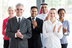 Group business people applauding. Group of cheerful business people applauding royalty free stock photography