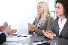 Group of business people applauding at meeting  in office.  Stock Photos