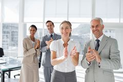 Group of business people applauding together. During a meeting Royalty Free Stock Image