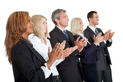 Group of business people applauding on white. Group of business people applauding isolated on white background Stock Images