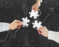 Group of business people assembling blank white jigsaw puzzles Stock Photo