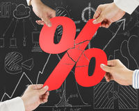 Group of business people assembling broken red percentage with d Royalty Free Stock Photos