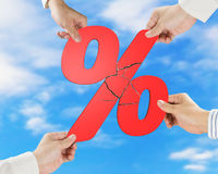 Group of business people assembling broken red percentage with s Royalty Free Stock Images