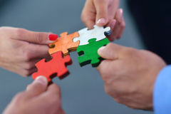 Group of business people assembling jigsaw puzzle Royalty Free Stock Photo