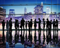Group of Business People in Back Lit Stock Images