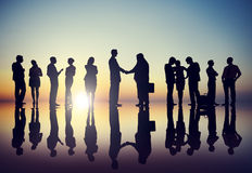Group of Business People in Back Lit Royalty Free Stock Images