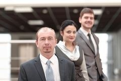Group of business people on the background of the office stock images