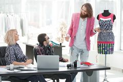 Group of business people brainstorming in a fashion clothing company.  stock photography