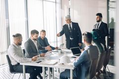 Group of business people brainstorming together in the meeting room stock photo