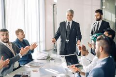 Group of business people brainstorming together in the meeting room stock photography