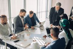 Group of business people brainstorming together in the meeting room royalty free stock image