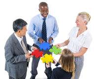 Group of Business People Building Jigsaw Royalty Free Stock Image