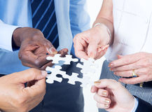 Group of Business People Building Jigsaw Royalty Free Stock Photography