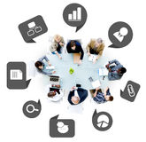 Group of Business People with Business Symbols Stock Photos
