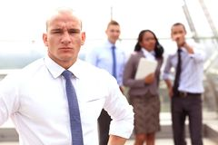 Group of business people with businessman leader. On foreground Royalty Free Stock Photo