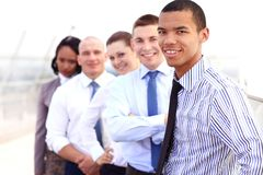 Group of business people with businessman leader. On foreground Royalty Free Stock Image