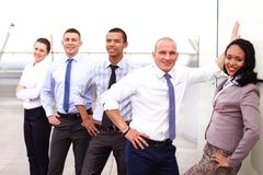 Group of business people with businessman leader. On foreground Stock Photos