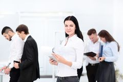 Group of business people with businessman leader on foreground. In office Royalty Free Stock Photos