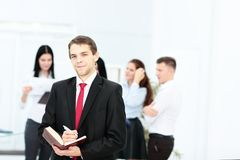 Group of business people with businessman leader on foreground. In office Stock Images