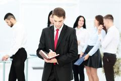 Group of business people with businessman leader on foreground. In office Stock Photos