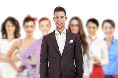 Group of business people with businessman leader in funny hat Royalty Free Stock Images