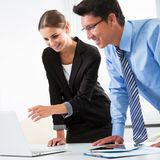 Group of business people. Businesspeople working with laptop in an office Stock Images