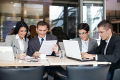 Group of business people in cafe Stock Image